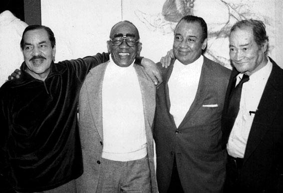 979, lors d'une Jazz Party chez Albert Vollmer, réunion des derniers membres du Mills Blue Rhythm Band: de g. à d., Crawford Wethington (cl,as,bs), Ed Andy Anderson (tp), Lawrence Lucie (g), Gene Mikell (ts), Larchmont, NY, 1979 © Albert Vollmer by courtesy